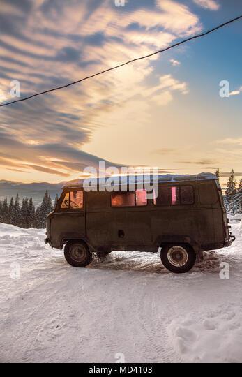 Camper van on covered landscape at sunset, Gurne, Ukraine, Eastern Europe - Stock Image