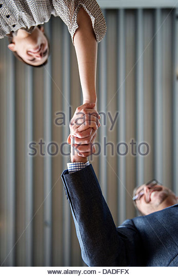Man and woman shaking hands - Stock-Bilder