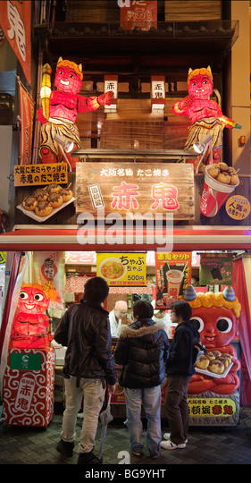A stand selling Takoyaki (octopus dumplings) in Dotonbori canal district, Osaka, Japan - Stock Image