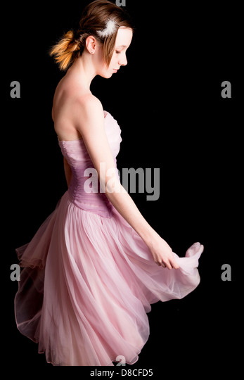 Youth, Teen, Teenage girl, pink, first love, dating,  dance, twirl, dress, pretty - Stock Image