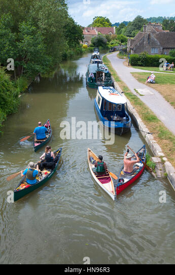 Canoeing and moorings on Kennet and Avon Canal at Bathampton, Somersert, England, UK - Stock Image