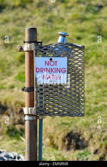 An Outside Tap With A Not Drinking Water Sign On   Stock Image