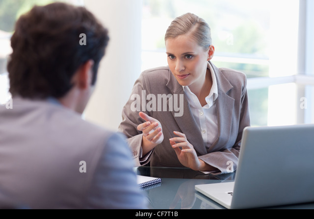 Professional businesswoman receiving a customer - Stock Image