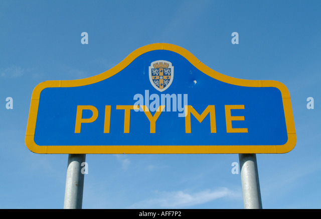 Entrance sign to the village of Pity Me on the outskirts of Durham City, England, UK. - Stock Image