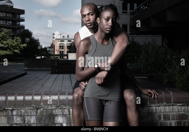 Man & woman in sports wear outdoors at city estate - Stock-Bilder