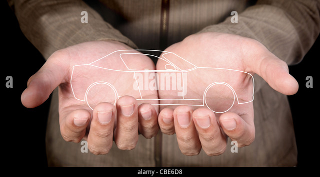 line-art car in human hands - Stock Image