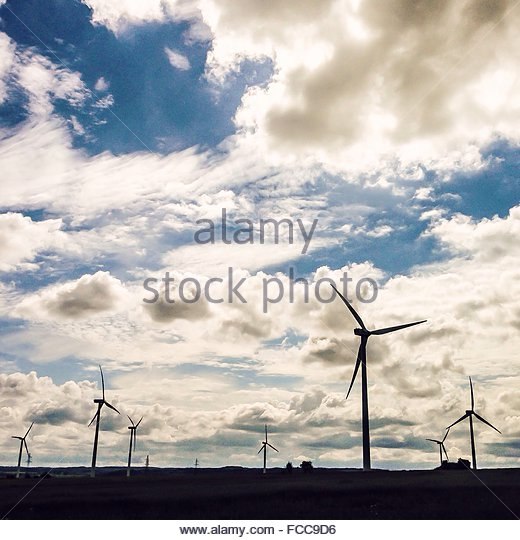 Cloudy Sky Over Wind Farm - Stock Image