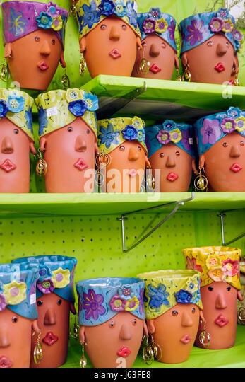 Indiana Chesterton Chesterton Feed and Garden Center shop retail home decor ceramic planter whimsical face earrings - Stock Image
