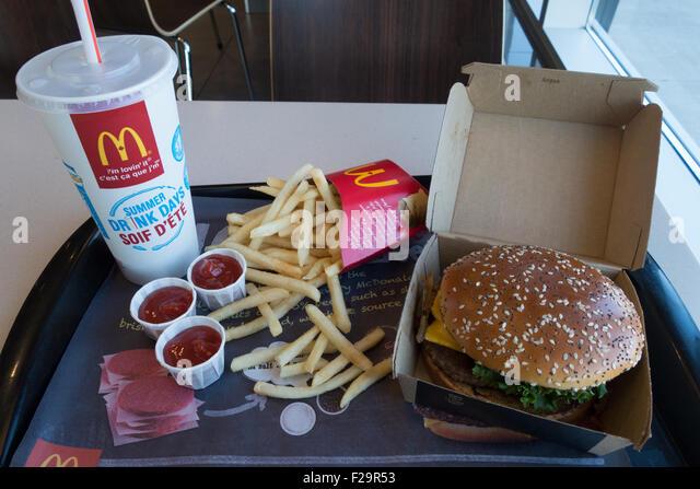 McDonalds combo meal burger fries soft drink - Stock Image