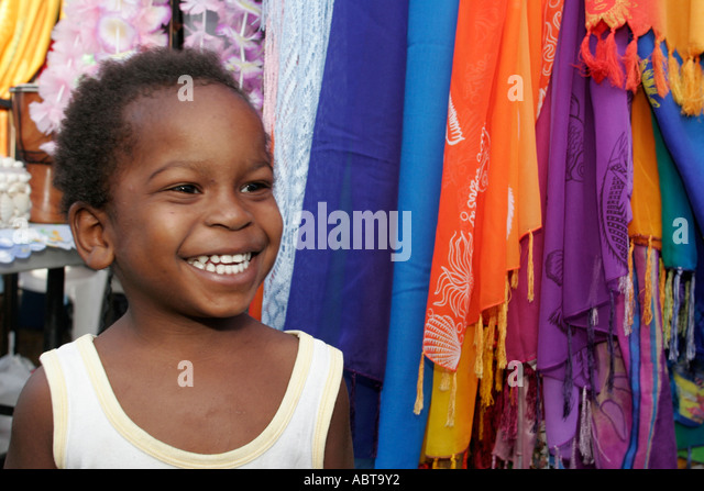 BVI Tortola Tent Village Road Town Cruise Port Black boy smiling - Stock Image