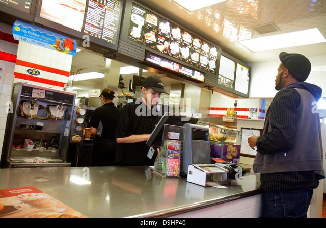 Nevada Las Vegas Sahara Avenue McDonald's fast food restaurant employee job behind counter taking order teen - Stock Image