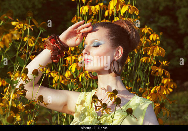 Relax. Daydreaming Woman over Floral Background with Flowers - Stock Image