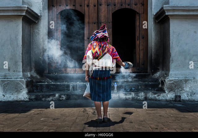 Chichicastenango, Guatemala - April 26, 2014: Mayan woman performing a ritual in front a church. - Stock Image