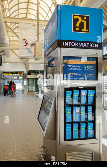 New York New York John F. Kennedy International Airport JFK terminal concourse gate area kiosk information Air Train - Stock Image