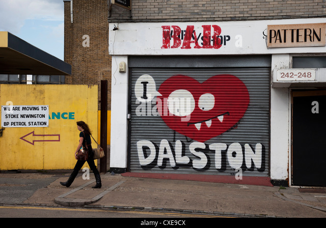 I Love Dalston street art graffiti shutters in this fashionable East End area of London, UK. - Stock-Bilder