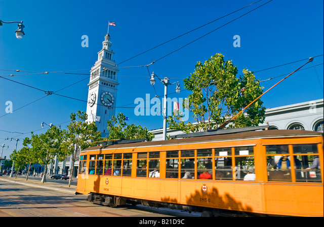 San Francisco, California. Tram on the Embarcadero with the Ferry Building. - Stock Image
