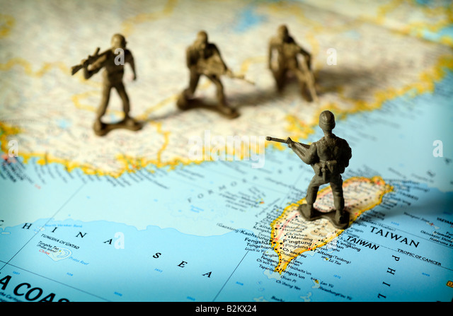 Toy soldiers on map of China and Taiwan face off against each other - Stock Image