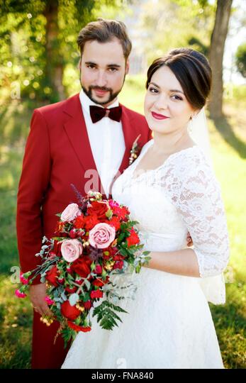 Portrait of newlyweds couple outdoors, summer. - Stock Image