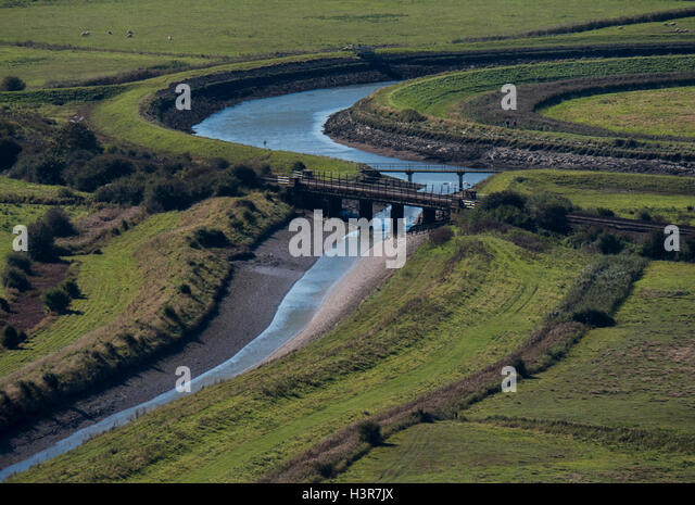 The Glynde Reach river (left) joins the River Ouse near the village of Glynde, East Sussex, England, UK - Stock Image