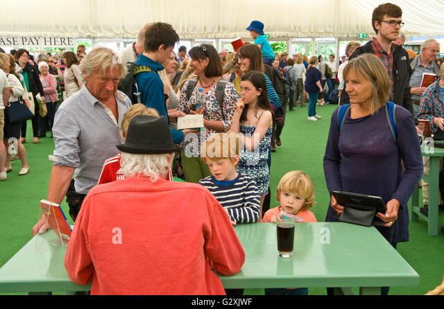 Roger McGough poet book signing for fans in the bookshop at Hay Festival 2016 - Stock Image