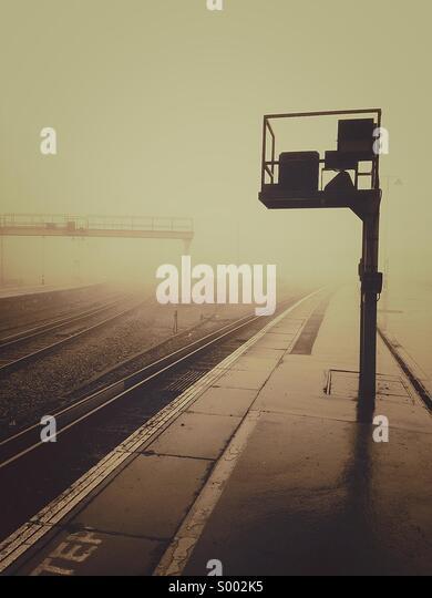 Foggy train station - Stock Image