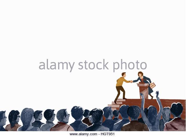 Audience applauding man receiving award on stage - Stock-Bilder