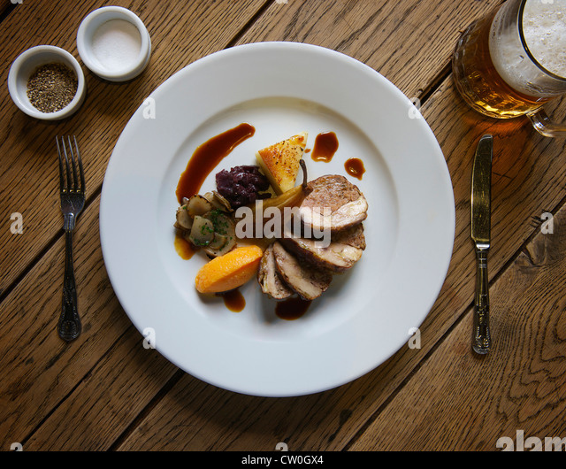 Plate of stuffed pork with pear - Stock Image