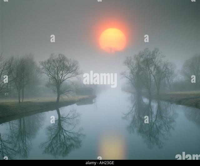 DE - BAVARIA: Sunset over River Loisach entering Lake Kochel - Stock-Bilder