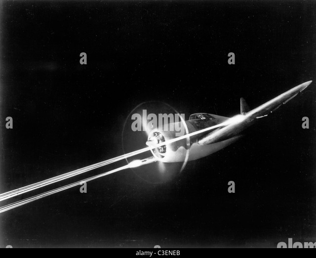 Republic P-47 aircraft. P-47 firing its M2 machine guns during night gunnery - Stock Image