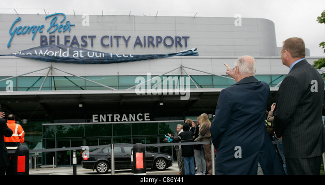 Dickie Best and Brian Ambrose watch the unveiling of Belfast City Airports new logo at George Best airport renaming - Stock Image
