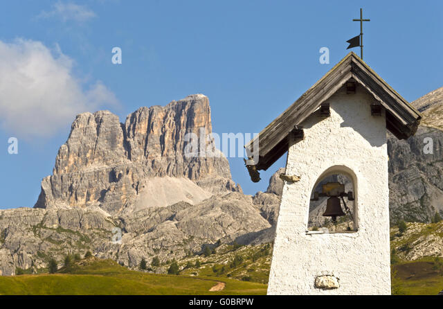bell tower with landscape of the italians mountains background in a summer day, Dolomiti - Italy - Stock Image
