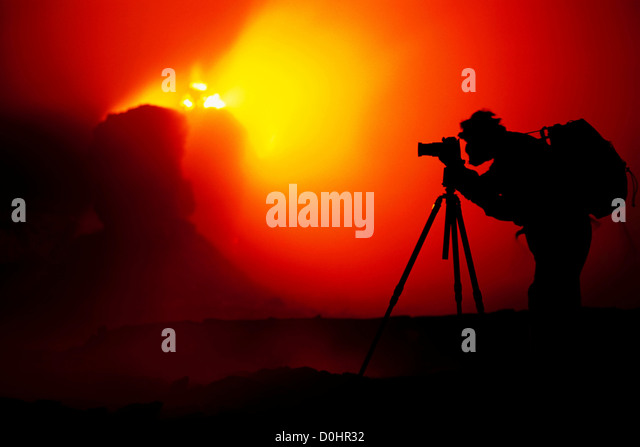 Photographer Silhouetted by Erupting Spatter Cones within Pu'u O'o Vent - Stock-Bilder