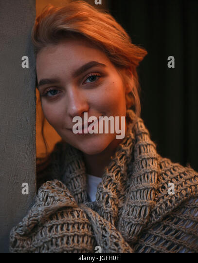 Portrait of smiling Caucasian woman wearing scarf - Stock Image