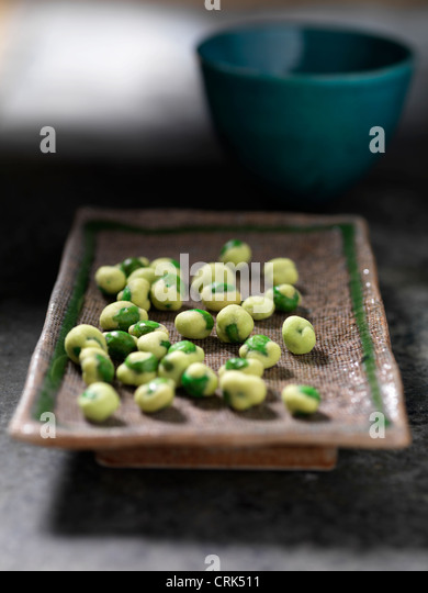 Close up of tray of wasabi peas - Stock Image