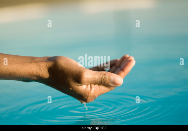 Cupped hand holding water - Stock Image