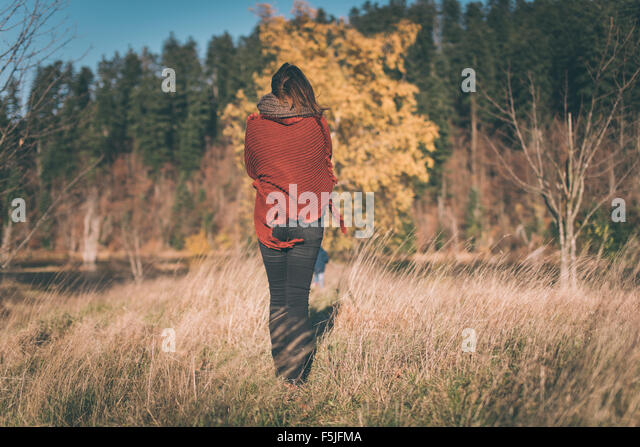 Woman in nature enjoys the view - Stock Image