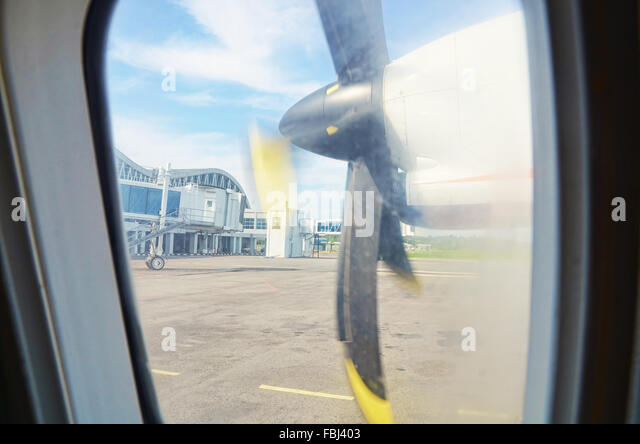 Plane's wing propeller sight from window view - Stock Image