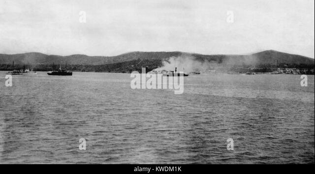 Distant view of US Maines landing at Guantanamo, Cuba, on June 6-10, 1898. The light cruiser USS MARBLEHEAD, - Stock Image