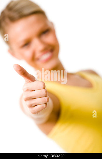 Image of female showing thumb up and smiling - Stock Image