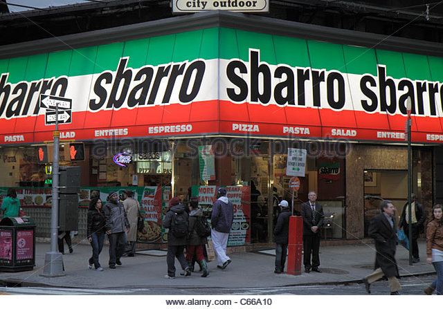 Manhattan New York City NYC NY Midtown Times Square street corner Sbarro pizzeria restaurant business signage sign - Stock Image