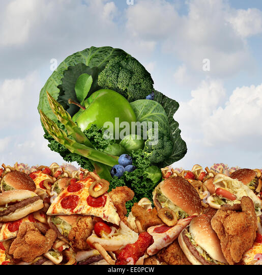 Drowning in fat concept as a human face made of fresh green vegetables and fruit struggling to survive from the - Stock-Bilder