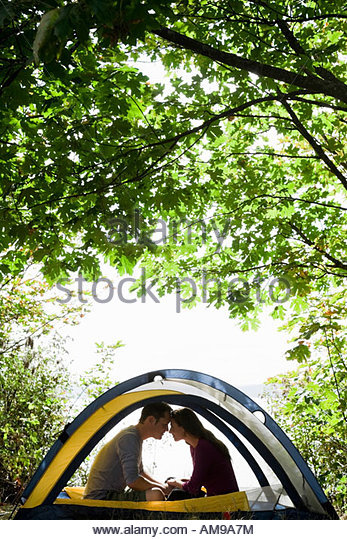 Couple sitting in tent - Stock-Bilder