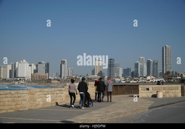 Tel Aviv skyline seen from waterfront promenade - Stock Image