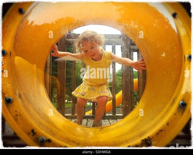 Toddler girl at the playground - Stock Image