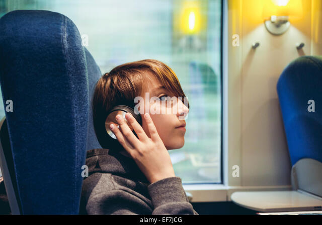 Boy listening to music - Stock Image