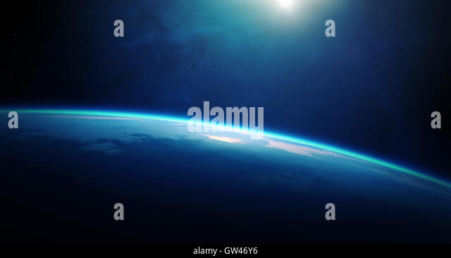 Sunrise over planet Earth with cloudy ocean and viewed from deep space - Stock Image