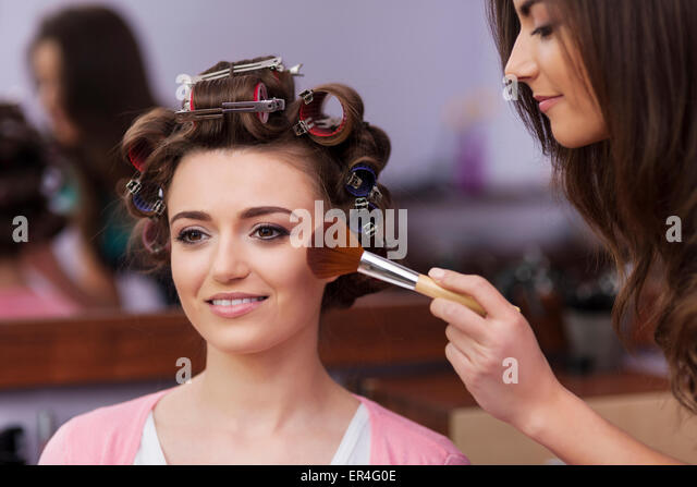 Makeup artist applying makeup by brush. Debica, Poland - Stock Image