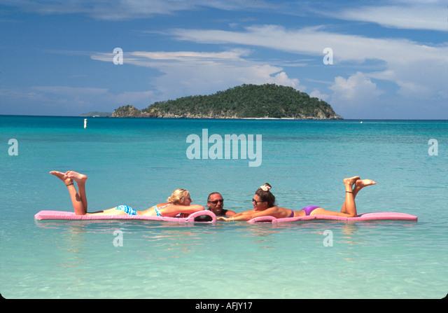 US Virgin Islands St. John Virgin Islands National Park Maho Beach Maho Bay visitors rafts USVI012 - Stock Image