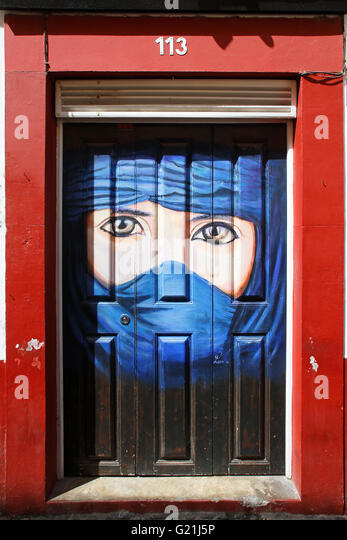 Veiled Woman, street art, Portrait, artistically painted door, historical centre of Funchal, Madeira, Portugal - Stock-Bilder