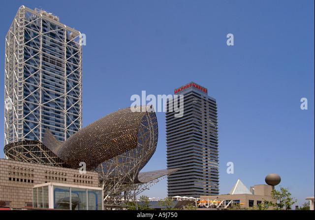 ESP Spanien Barcelona beach Platja de la Barceloneta Hotels Arts Sculpture of Frank Gehry Passeig Maritim Promenade - Stock Image